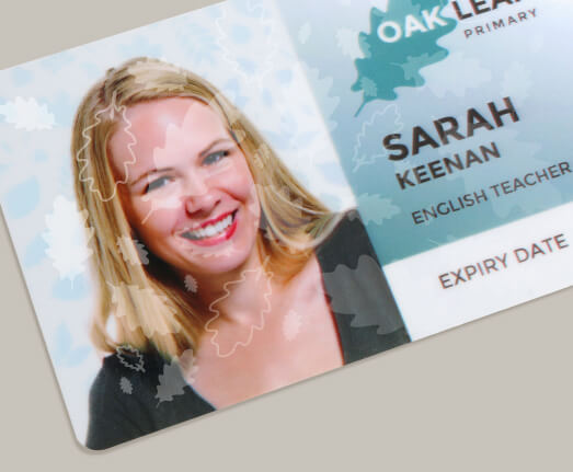Printed staff photo ID card showing SmartMark advanced security feature.