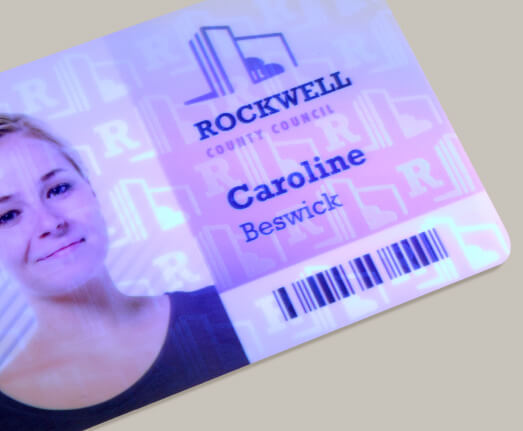 Printed photo ID card showing UV ink security feature.